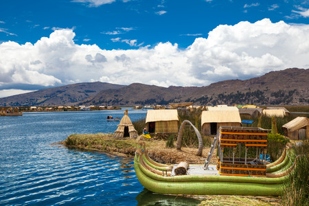 PERU - MAY 11, 2015: Unidentified women in traditional dresses welcome tourists in Uros Island