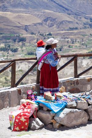 CABANACONDE, PERU - MAY 15 2015: Unidentified women selling souvenirs at Cruz Del Condor viewpoint.