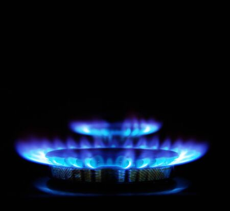 incandescence: flames of gas stove in the dark       Stock Photo