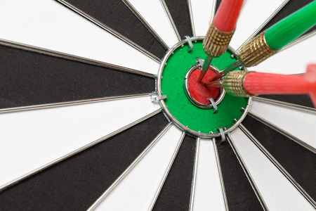 darts arrows in the target center Stock Photo