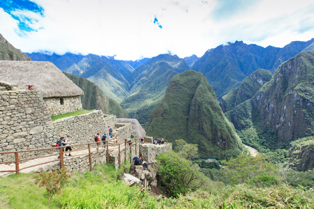 top 7: MACHU PICCHU NOVEMBER 11: Tourists walk in Machu Picchu site on November 11 2015 in Machu Picchu. Editorial