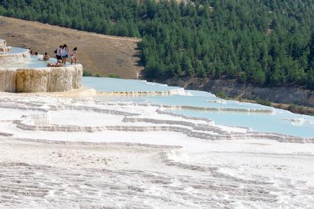 pamuk: Pamukkale, Turkey - August, 14 2015: Tourists on Pamukkale Travertine pools and terraces.