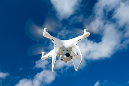 Drone fly in the blue sky