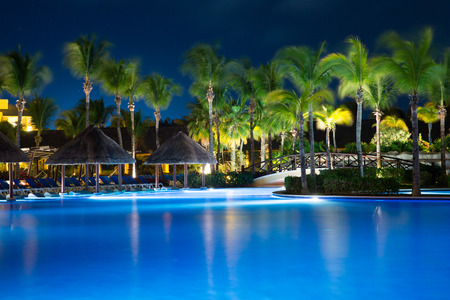 swimming pool in night illumination. tropical resort at night