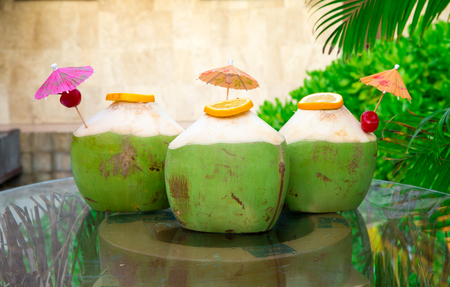 Sweet green coconuts water with drinking  Stock Photo