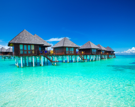 Maldives water bungalow on ocean water landscape Editorial