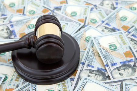 judge gavel and money on brown wooden table concept