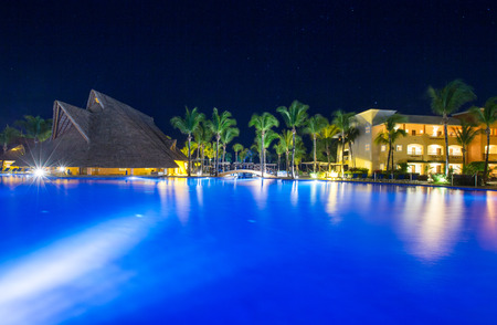 Swimming pool at a luxury Caribbean, tropical resort at night Editorial