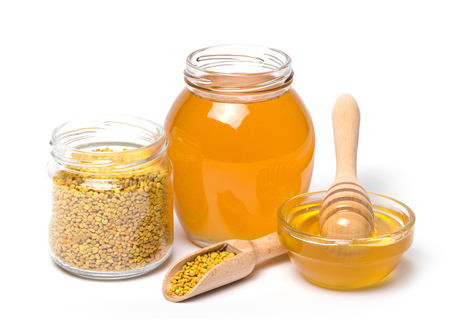 honey dipper and honey on white background