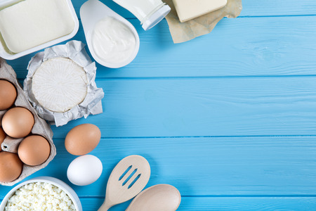 Fresh dairy products on blue wooden background Stock Photo