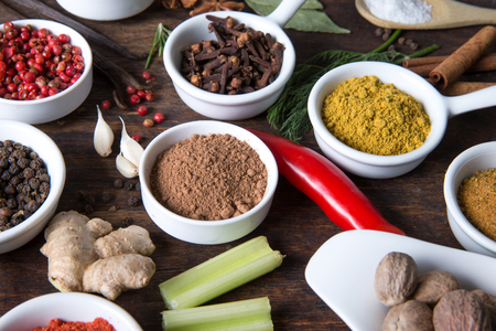 Herbs and spices in ceramic bowls. Aromatic ingredients and natural food additives.
