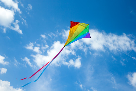 Kite flying in the sky among the clouds 写真素材