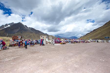 PERU - SEPTEMBER 6, 2015: Unidentified women selling the traditional local textile items on the La Raya Pass near Sicuani, Peru