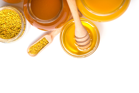 honey dipper and honey in jar on white background Stock Photo