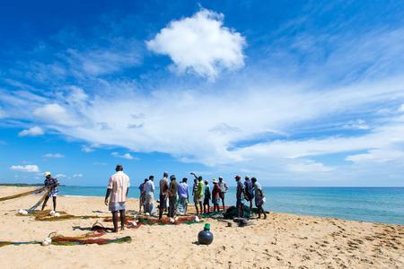 SRI LANKA - Mach 23: Local fishermen pull a fishing net from Indian Ocean on Mach 23, 2017 in Kosgoda, Sri Lanka. Fishing in Sri Lanka is the way they earn their living.