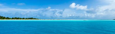 Maldives beach resort panoramic landscape. Summer vacation travel holiday background concept. Maldives paradise beach. Stock Photo