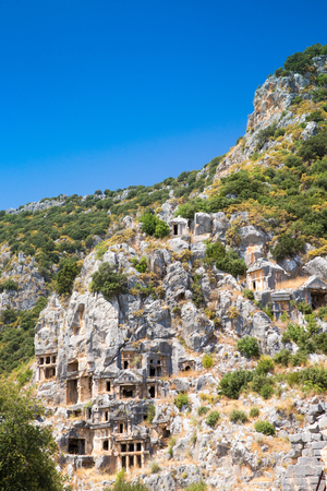 Ancient lycian necropolis with tomb carved in rocks in Mira
