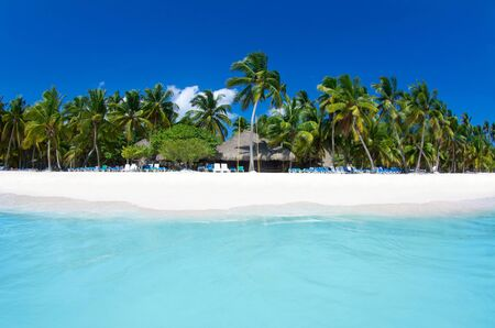 Beach and beautiful tropical sea. Caribbean summer sea with blue water. White clouds on a blue sky over summer sea. Tropical sea relax. Stok Fotoğraf - 132614410