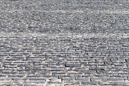 Paving stone vintage road cover. Evening road in a historical place