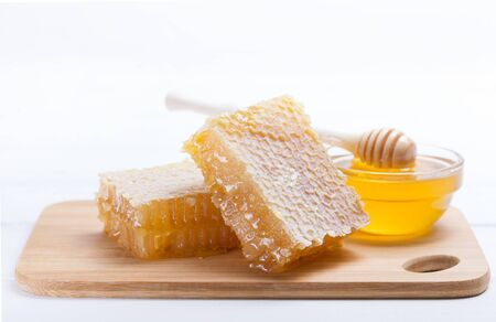 honey dipper and honey in jar on white background Фото со стока