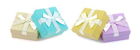 Christmas box gifts with satin bow isolated on white background Фото со стока