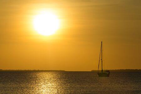 Sunset on sea in Zanzibar Фото со стока