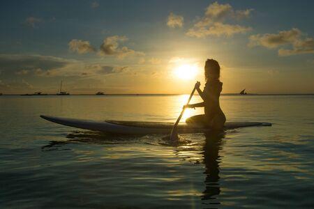 Happy woman relaxes on beach Фото со стока