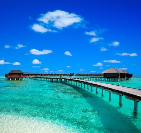 tropical beach in Maldives. Travel, Tourism and Vacations Concept.
