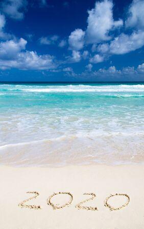 2020 year on the sand beach near the ocean