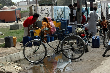 PAKISTAN_KARACHI_ Shortage of drinking water is in fat of Pakistani nation,specail muhala and backward aarea of Karchi poeple has to spen hours andhour to just get driking water,some home do not have acces to water pump or any state connection,people are