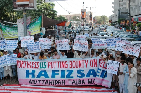 karachi: PAKISTAN_KARACHI_ Pakistanis supporters of Jamaat-Ud-Dawa stanged protest rally against usa and burn united states flag and denouse 10 millions USD bouty on Hafiz Saeed ,banner reads in udu that  Hafiz Saqaed is not terrorest he peace educate ,protesters