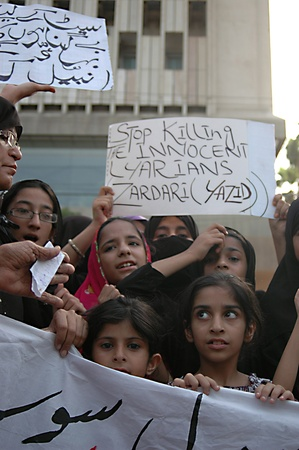 karachi: PAKISTAN_KARACHI_Lyariy women stage protest really  against Zaradari government  poster read Stop killing the inocent  Layraian Zardari (Yazid )infront of Karachi Press Club today on tuesday 1 May 2012