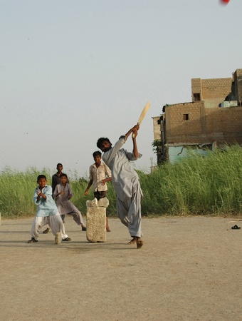 PAKISTAN_ KKARACHI_pakistani children playing  cricket at christion garve yard {Gora Qabristan} in karachi.on may,03,2012