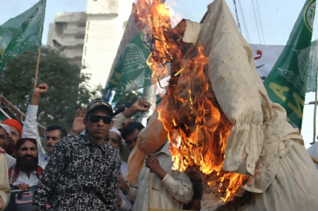 jones: PAKISTAN_KARACHI_Pakistanis condemn and  staged protest rally against Pastor Jones from Florida,usa Jones 20  other people took part to burning Muslim Holy Book Koran last week in his church in Florid ,usa, Pakistani staged protes rally today on firday 4  Editorial