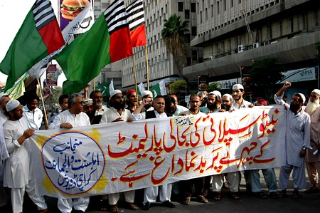 PAKISTAN_KARACHI_Dife_e-Paksitani council religious parties staged rally against Uunited States of American and Nato supplies slogan read American slavery unacceptable