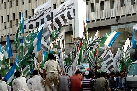 unacceptable: PAKISTAN_KARACHI_Dife_e-Paksitani council religious parties staged rally against Uunited States of American and Nato supplies slogan read American slavery unacceptable