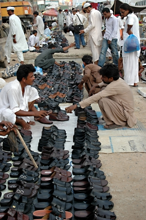 PAKISTAN_KARACHI_ Pakistani shoe vandors or fooptpath shoe shoppers ,these shoe vandor do not pay andy rent to state tax or pay for rent a plave on footpath or small business men 18 June 2012