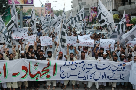 insulting: KARACHIPAKISTAN_  Pakistani  staged proetst aginst  Uunited States of America and   againt film insulting islam and banner read death over them insult islam and prophet protesting holding banners during protest rally in Karachi today on 14 Sept. 2012