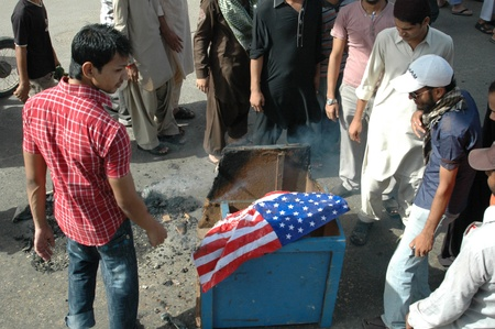 KARACHIPAKISTAN_ Protestors set autos on fires during protest rally against anti Islam film and   and against usa ,film is made in the usa and protests show their anger by buring cars when  government call 21 Sept. 2012