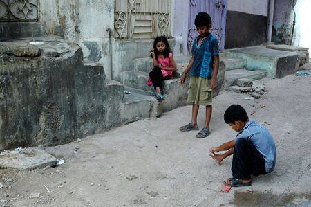 KARACHIPAKISTAN_ Christian children playing games called Bante ( small galss ball) thgis is very popuar sport among boys ,morjority christians live in Azam Basti backward are of Karchi 25 Sept. 2012