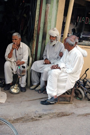 eldlery: KARACHIPAKISTAN_ Pakistani struggle for daily life male own Wafash cycle works and senior smoking water pipe ,since sneior has no plce to go in their free time there are no senior home, most  of senior spend time on shop or in street Azam basti 26 Sept.