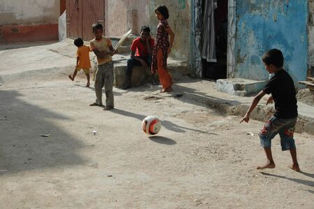 karachi: PAKISTAN_KARACHI_pakistani christian children playing cricket on street in karachi. sept,26,2012