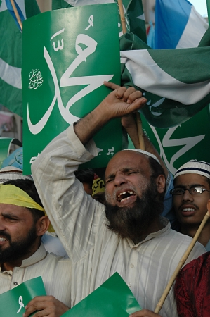 blasphemy: KARACHIPAKISTAN_ Supporters of thr Jamaate-e-islami  staged proetst rally against USA and anti islam film ,film made in usa  and walked on USA flag star and stripes and burt usa flags in Karachi tdoay with banner Go America Go , 7 October 2012        Editorial