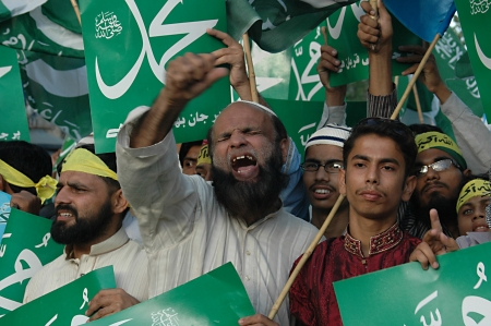 blasphemy: KARACHIPAKISTAN_ Supporters of thr Jamaate-e-islami  staged proetst rally against USA and anti islam film ,film made in usa  and walked on USA flag star and stripes and burt usa flags in Karachi tdoay with banner Go America Go , 7 October 2012