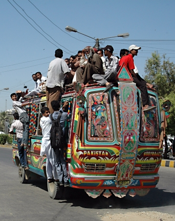 dean lake: KARACHIPAKISTAN_  People sitting on bus roog which is very danergous bus ride due to lake of Government transport system, Pakistani Government need to take better for safty of theri nationals 5 Oct. 2012         (Photo by  Ilyas J. Dean  Pak Images)