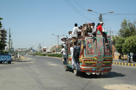 karachi: KARACHIPAKISTAN_  People sitting on bus roog which is very danergous bus ride due to lake of Government transport system, Pakistani Government need to take better for safty of theri nationals 5 Oct.2012
