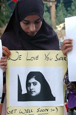 KARACHI/PAKISTAN_ Pakistani nation people stand with 14 years Pakistani brave girl who was shot by Talila ban in recent attach on school van, poster reads we love you sister get well soon ,pakistani during protest rally in support of Malala Yousafzai toda Stock Photo - 15740049