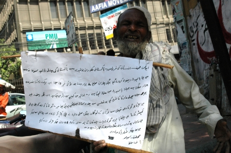 KARACHIPAKISTAN_A bangali Pakistan male staged protest against Pakistan passport authority as banner read that he paid ten thousand Pakistan rupees to poassport authorityn and they did not delivery passort to hon given date  he demond his money return to