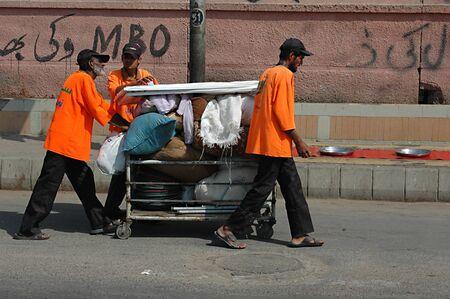 jinnah: KARACHIPAKISTAN_   Saylani org.distribute free food to poor at infront of Jinnah hopsital 25 Oct. 2012