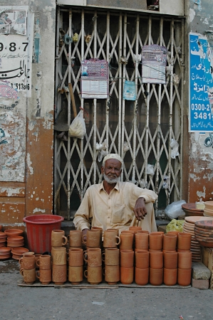 eldlery: KARACHIPAKISTAN_  Pakisani eldlery male selling mug made clay 31 Oct 2012        Editorial